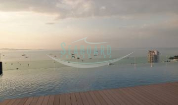 large swimming pool with terrace sunset centric sea condominium one bedroom for rent sale